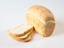 Bread. Loaf of bread with grains on a white background Stock Image