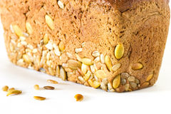 Bread. Whole brown bread with grain isolated on a white background Royalty Free Stock Photography