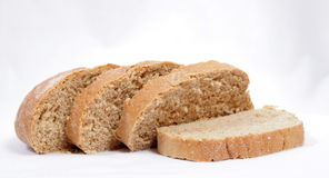 Bread. Brown bread isolated on white Stock Images