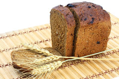 Bread. Rye bread with spikelets on a white background Stock Photos