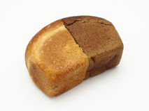 Bread. Two halves of white and black bread lie on a white background Royalty Free Stock Photos
