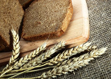 Bread. Wheat bread in the sacking of spike Royalty Free Stock Photography