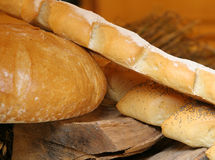 Bread. Different types of bread put on the wood Stock Photography