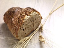 Bread. A bread made of whole grain flour on a wooden surface royalty free stock photography