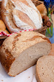 Bread. And Rolls in Basket on the Table Royalty Free Stock Photos