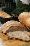 Bread. Close up of home baked bread on display on the garden table. Shallow DOF Stock Images