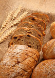 Bread. And wheat on burlap background Royalty Free Stock Images