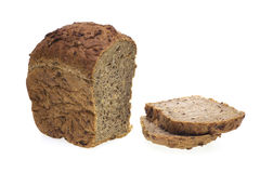 Bread. Loaf of cereal rye bread and two slices isolated on white background Royalty Free Stock Image