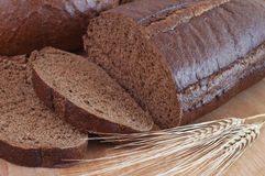 Bread. Black bread and wheat spikelets stock photography
