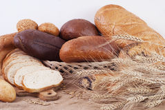 Bread. Composition of bread and wheat spikelets royalty free stock image