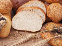 Bread. Composition of bread and wheat spikelets stock photos