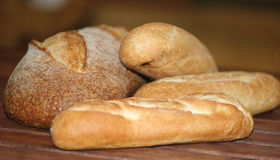 Bread. A closeup of several loaves of bread on a wooden tabletop Royalty Free Stock Photo