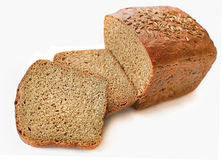 BREAD. Stack of sliced whole rye bread on isolated white background Royalty Free Stock Images