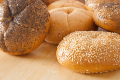 Bread. Assorted kaiser roll breads. Some are plain, some have poppy seeds, and the others have sesame seeds. Selctive focus. Shallow DOF Stock Image