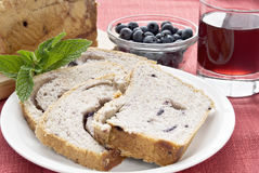 Bread. Blueberry cobbler bread served with blueberries, grape juice and garnished with mint Royalty Free Stock Image
