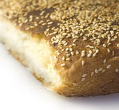 Bread. Piece of bread sprinkled with sesame seeds stock photo