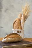 Bread. Two loafs of sour dough bread with bundle of wheat Stock Images