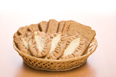 Bread. In a plate from straw on a table Royalty Free Stock Image