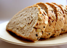 Bread. Whole meal breads on a plate royalty free stock images