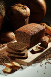 Bread. Wholemeal bread over cutting table Royalty Free Stock Photos