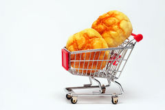 Bread. In shopping cart on white background Royalty Free Stock Images