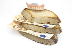 Bread And Money Stock Photography
