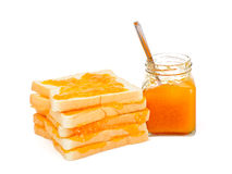 Bread with apricot jam. Isolated on white background Stock Photo