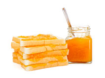 Bread with apricot jam Royalty Free Stock Photography