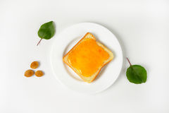 Bread with apricot jam Royalty Free Stock Photos