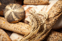 Bread assortment on wooden surface Royalty Free Stock Image