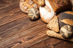 Bread assortment on wooden surface Royalty Free Stock Photo