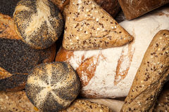 Bread assortment on wooden surface Stock Images