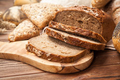 Bread assortment on wooden surface Stock Photos