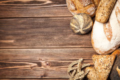 Bread assortment on wooden surface Stock Photography