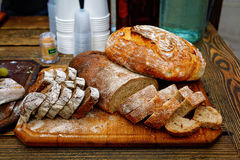 Bread assortment on a wooden table Stock Photos
