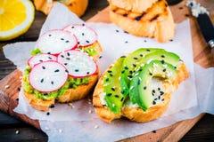 Bread with avocado, radish and sesame royalty free stock photo