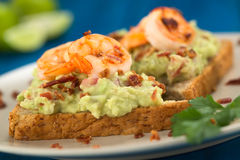 Bread with Avocado, Shrimp and Bacon Stock Images