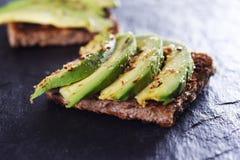 Bread with avocado royalty free stock photos