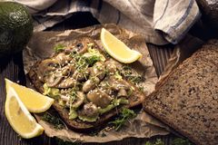 Bread with avocado spread and champignons. Protein bread with avocado spread and champignons stock images