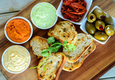 Bread with avocado tomato salsa mint and mayo dip Stock Photos