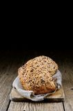 Bread background. Close up of bread over a wood background Royalty Free Stock Photo