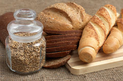 Bread, baguette and pot with grains Royalty Free Stock Photography