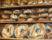 Bread baked according to old German recipes in a small family bakery. Loaves of bread weighing on the shelf Stock Photo