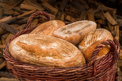 Bread baked in the wood oven in the basket Royalty Free Stock Photo