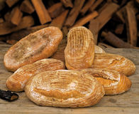 Bread baked in the wood oven in the basket.  Royalty Free Stock Photo