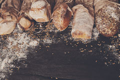 Bread bakery background. Brown and white wheat grain loaves composition Royalty Free Stock Photo