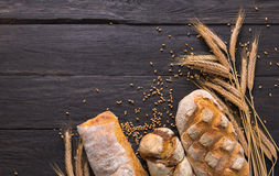 Bread bakery background. Brown and white wheat grain loaves composition Stock Image