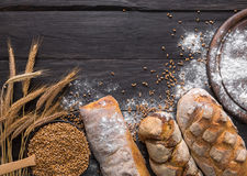 Bread bakery background. Brown and white wheat grain loaves composition Stock Photography