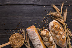 Bread bakery background. Brown and white wheat grain loaves composition Royalty Free Stock Photography
