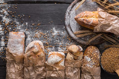 Bread bakery background. Brown and white wheat grain loaves composition Royalty Free Stock Photos